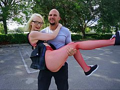 Petite blonde in fishnets banged by a huge guy
