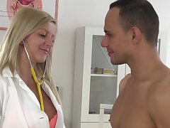 Busty blonde doctor Summer rides her patients big cock