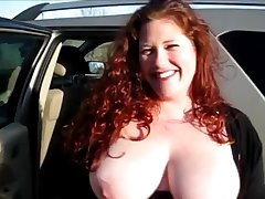 Tiro redhead with massive natural breasts vulnerable her knees giving a BJ