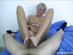 Mature sure likes pleasing the boy with footjob